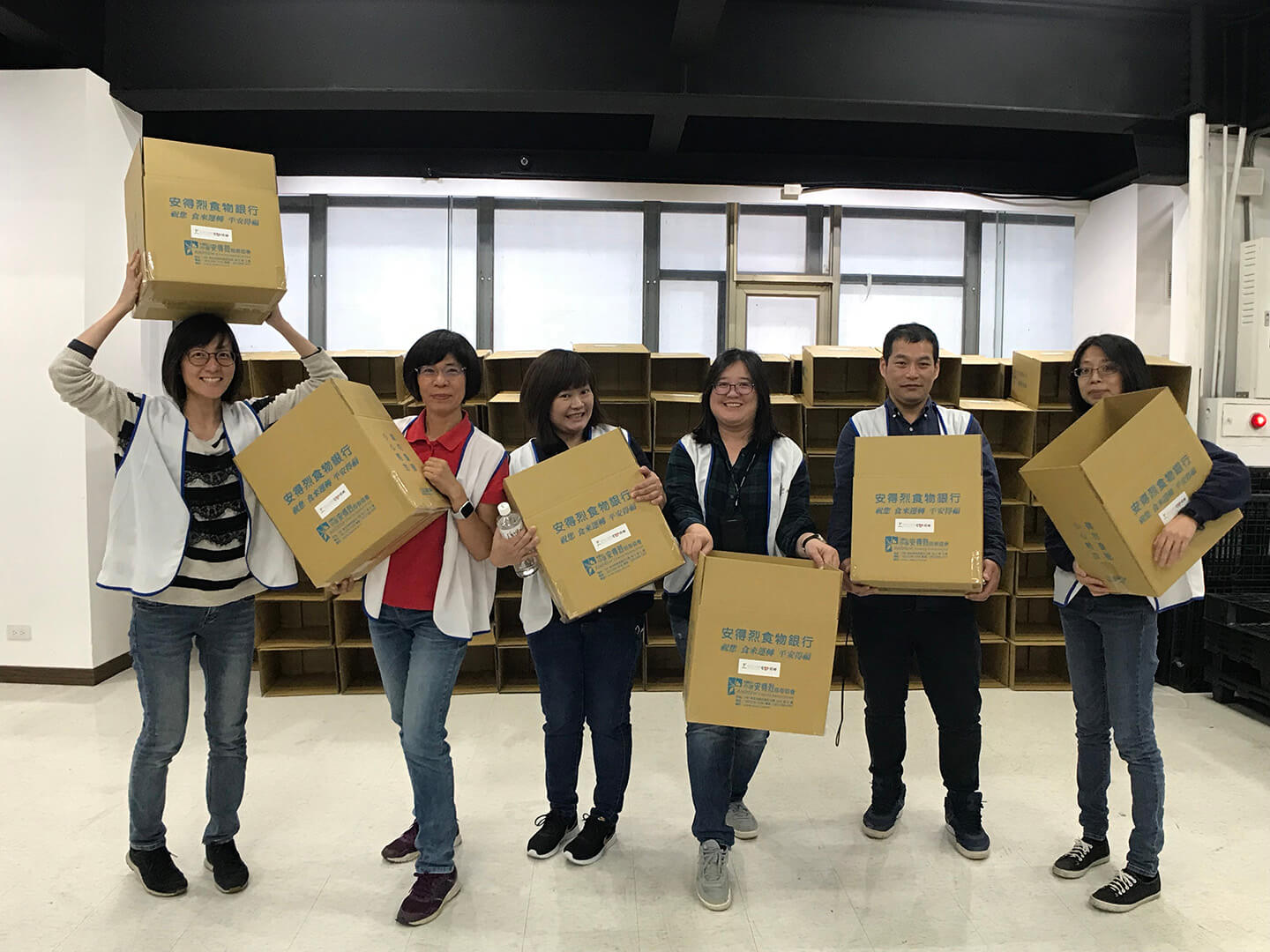 accton employee volunteering activity packing food boxes